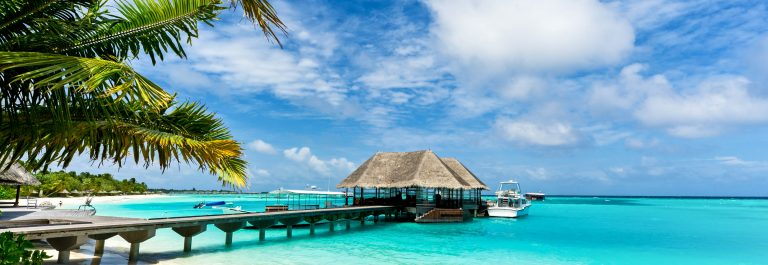 footbridge connecting with thatched jetty in maldives resort