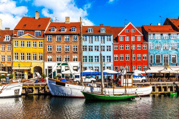 Scenic summer view of color buildings of Nyhavn in Copehnagen Denmark shutterstock_134874083-2