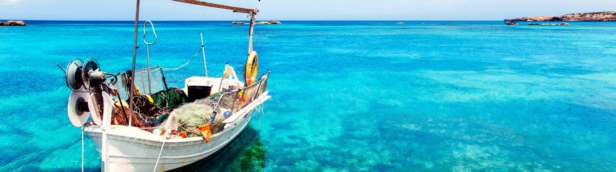 Els Pujols beach in Formentera with traditional fishing boat in summer day shutterstock_107515358-2