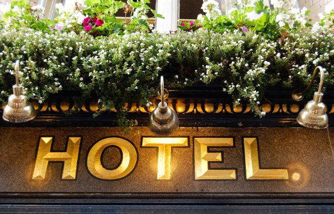 golden hotel sign – close up shutterstock_219379825-2