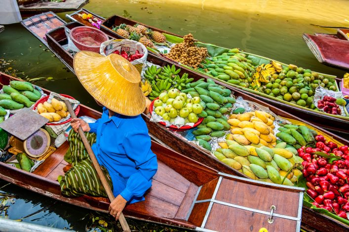 """Boats loaded with fruits in Damnoen Saduak Floating Market, Thailand"""