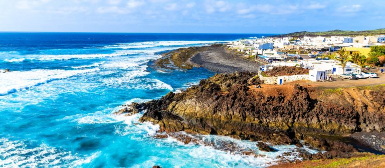 View of El Golfo village and blue ocean on coast of Lanzarote shutterstock_269113607-2