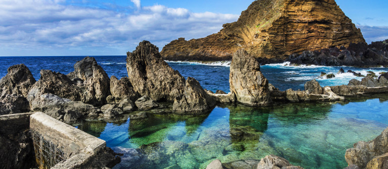 Swimming natural pools of volcanic lava in Porto Moniz, Madeira shutterstock_289240448