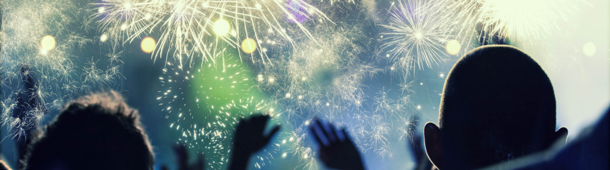 New Year concept – cheering crowd and fireworks