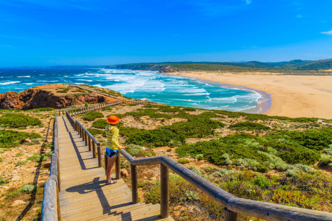 young-woman-tourist-on-walkway-to-praia-do-bordeira-beach-shutterstock_280701572-2