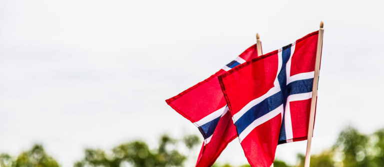 Two Norwegian flags blowing in the wind