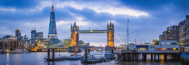 London Tower Bridge and The Shard illuminated over Thames panorama