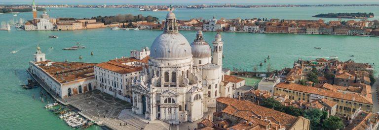Aerial-view-of-Basilica-di-Santa-Maria-della-Salute-in-Venice_shutterstock_1055755679