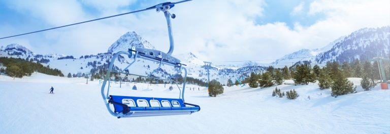 ski-lift-seat-over-the-pistes-in-mountains-in-grandvalira-andorra_shutterstock_143413042