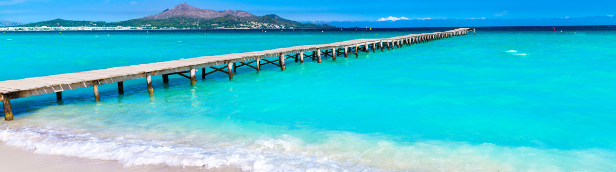 Majorca Platja de Muro beach pier in Alcudia bay in Mallorca Balearic islands of Spain shutterstock_270339830-2