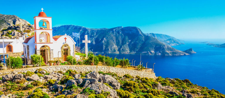 Sea bay on Greek Island with white church
