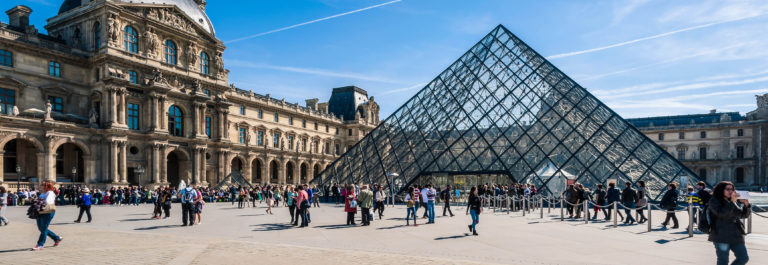 Tourists in the Louvre's central courtyards.