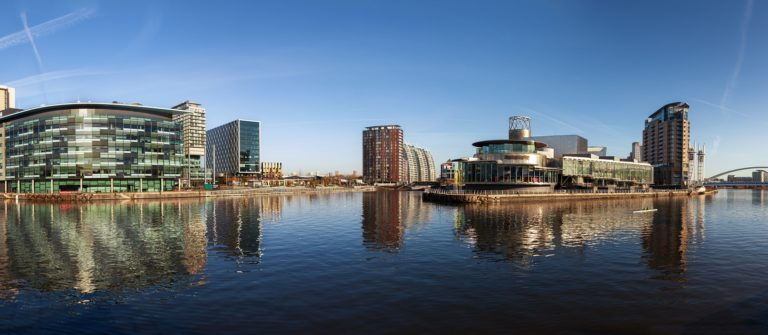Panoramic view of Salford Quays Manchester, with BBC Manchester, Media City and Lowery theater all together._shutterstock_136399211