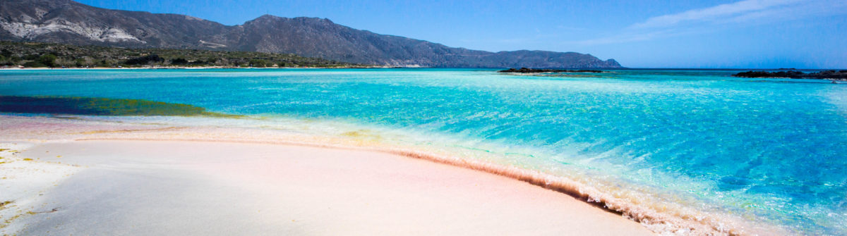 A beach in Crete, Greece with crystal clear blue water