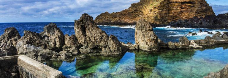 Swimming natural pools of volcanic lava in Porto Moniz, Madeira shutterstock_289240448