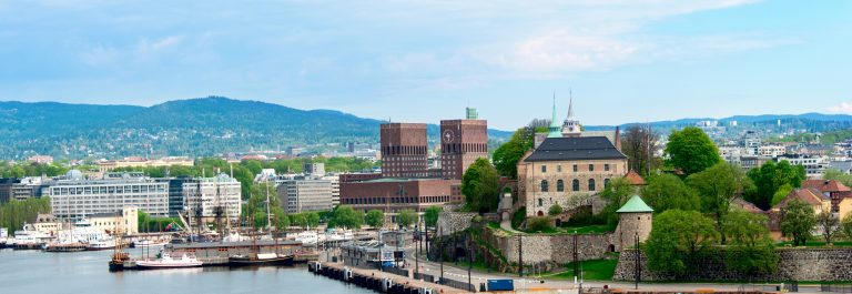View of Oslo, Norway Radhuset (city hall) and Akershus castle from the sea_shutterstock_155848862