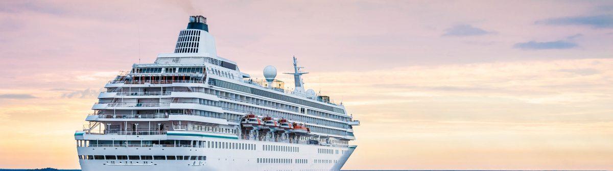 Big cruise ship in the sea at sunset. Beautiful seascape shutterstock_269340617-2
