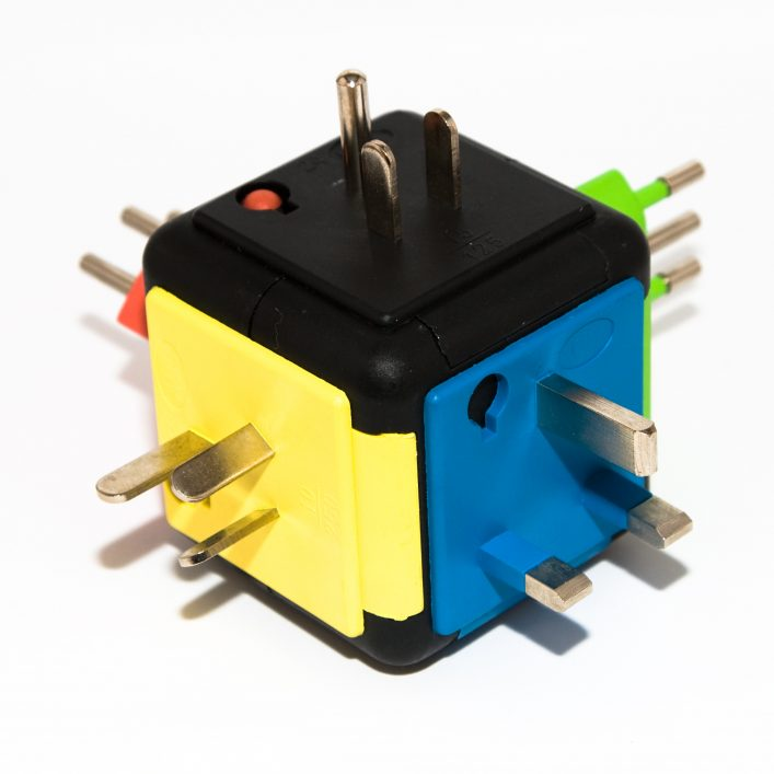 A colorful handy travel plug adapter