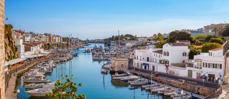 Menorca View on old town Ciutadella sea port on sunny day shutterstock_554710495