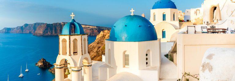 Local church with blue cupola in Oia, Santorini, Greece