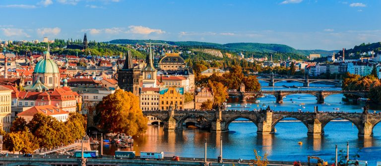 Vltava River and Charle bridge with red foliage