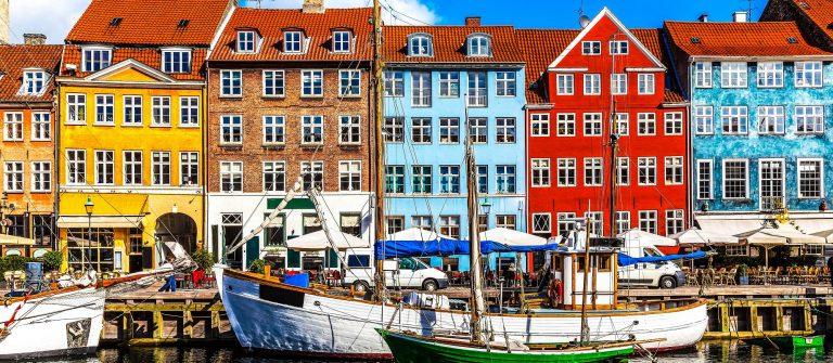 Scenic summer view of color buildings of Nyhavn in Copehnagen Denmark shutterstock_134874083-2-2