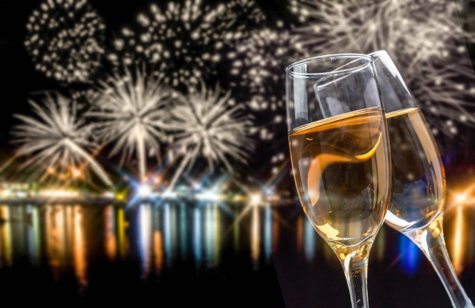 Celebrating New Year with champagne and fireworks