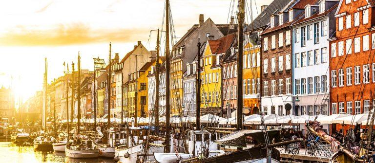 Colorful houses in Copenhagen old town at sunset Denmark shutterstock_379866352-2