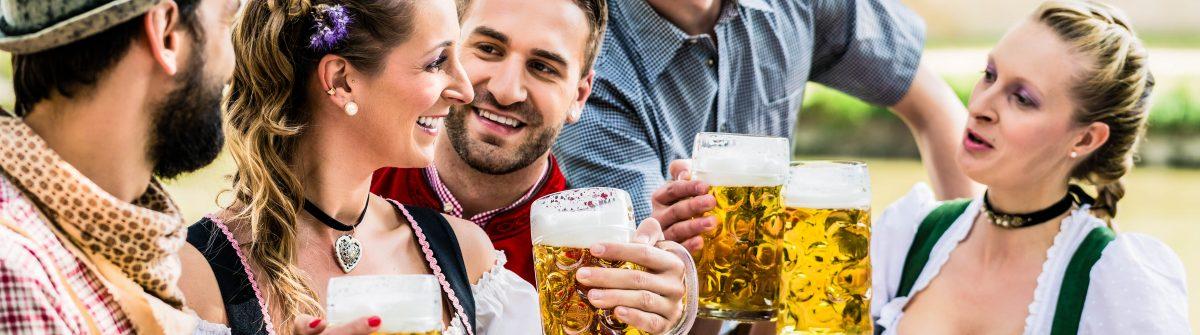 Friends in Bavarian beer garden drinking in summer shutterstock_316204055-2