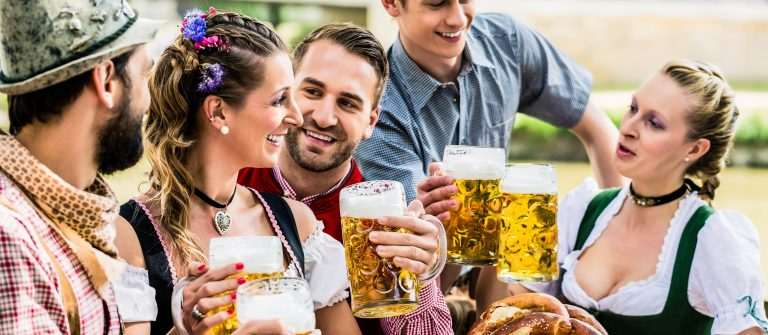 Friends in Bavarian beer garden drinking in summer shutterstock_316204055-2