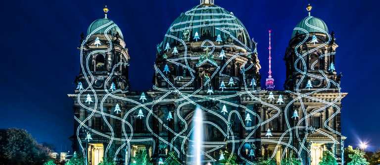 Berliner Dome illuminated by colorful images during the world famous Festival of Lights shutterstock_217844287 EDITORIAL ONLY View Apart-2