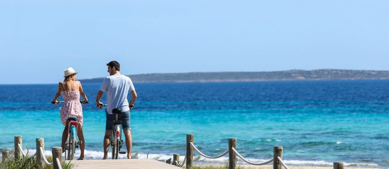 Couple riding bikes on Formentera Island shutterstock_187606058-2