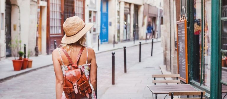 Woman walking through Paris France shutterstock_427200133_1000px