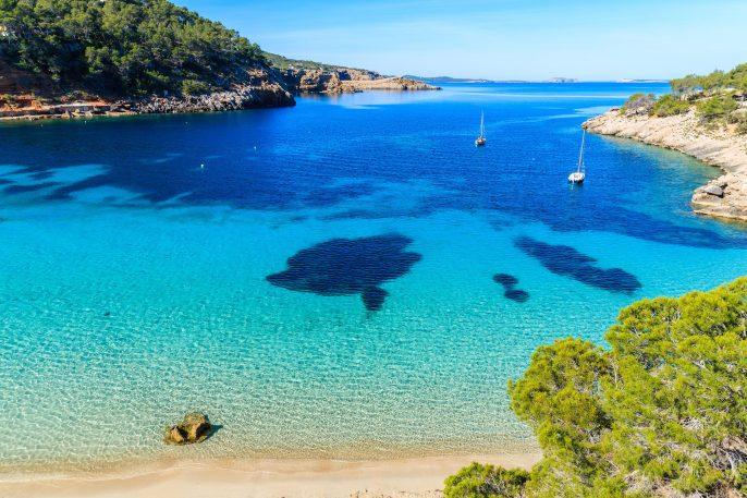 Cala Salada famous for its azure crystal clear sea water, Ibiza island, Spain shutterstock_660958126