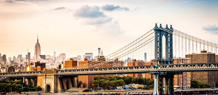 Manhattan Bridge and the New York skyline before sunset