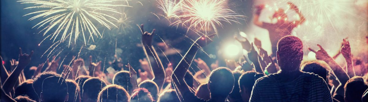 Crowd celebrating with fireworks