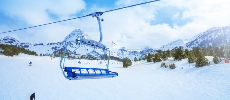 Ski lift seat over the pistes in mountains in Grandvalira Andorra_shutterstock_143413042