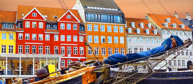 Copenhagen, Denmark Yacht and color houses in seafront Nyhavn shutterstock_247564465-2