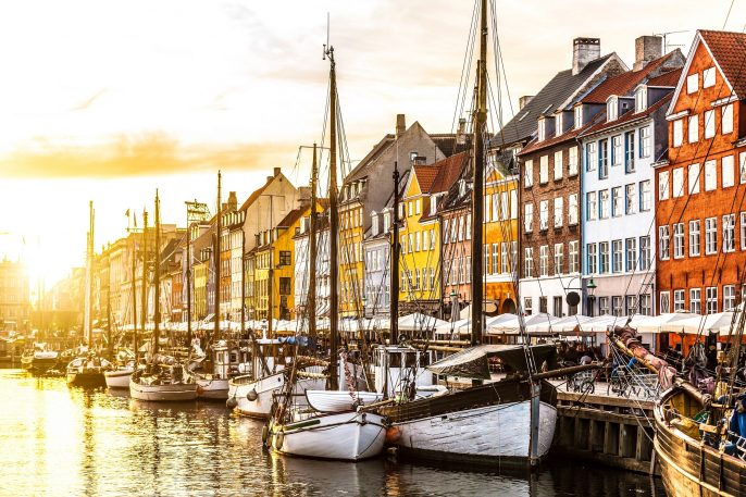 Colorful houses in Copenhagen old town at sunset Denmark shutterstock_379866352-2