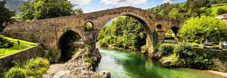 Old Roman stone bridge in Cangas de Onis (Asturias), Spain_151453073
