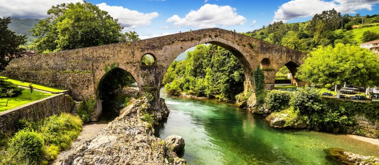 Old Roman stone bridge in Cangas de Onis (Asturias), Spain_151453073
