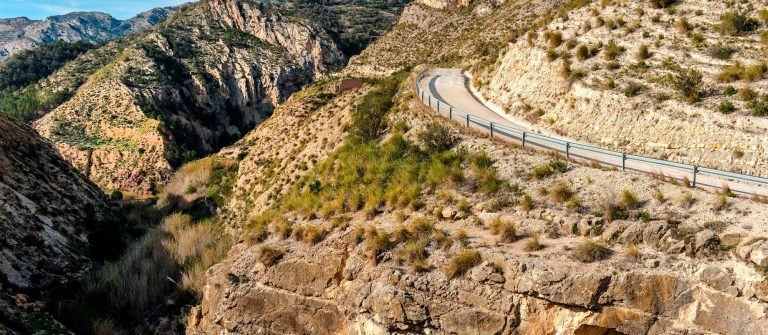 Scenic rocky mountains, road to the El Salt in Jijona. Spain alicante_415889158
