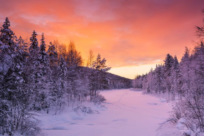 Sunrise over a river in winter near Levi, Finnish Lapland