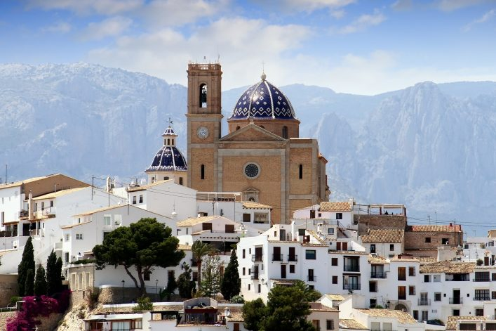 Touristic town of Altea and church with Sierra de Bernia mountain in the south east of Spain_296886389