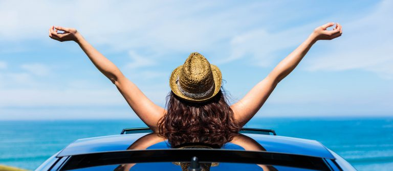 Woman on car travel enjoying freedom