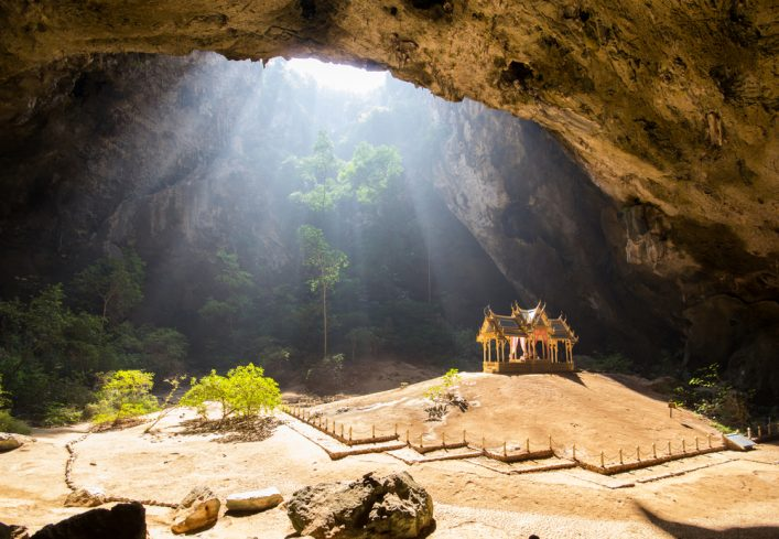 Morning sunbeam on golden buddhist pavilion in wild cave, Sam Roi Yot, Thailand_202702552