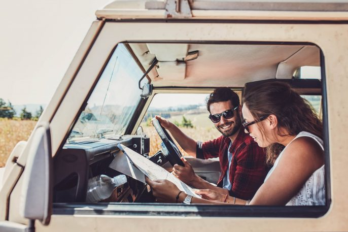 Couple looking at the map in their car