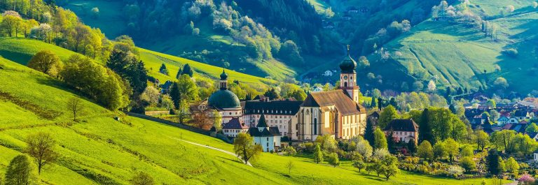 Beautiful countryside mountain landscape with a monastery in village shutterstock_286284614-2