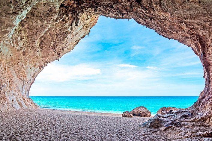 Cala Luna cave by the sea Sardinien Italien Italy shutterstock_192510971-2