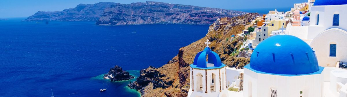 White architecture and famous little churches with blue domes